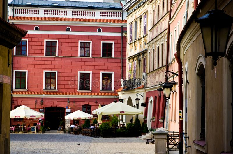 Lublin Poland, Old Town street with colorful house facades. Lublin, Poland, July 2019: the Old Town street with colorful houses facades on a sunny evening stock images