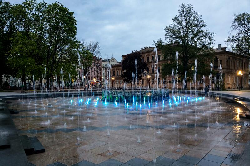 Lublin, Poland - May 14, 2019: Large pedestrian area with beautiful fountains in the evening royalty free stock image
