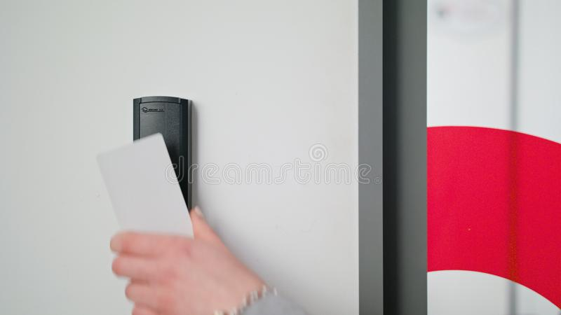 Woman Using Intercom at Residential Building stock images