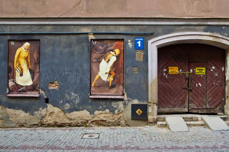 Lublin Poland, Old Town street with retro paintings in the window stock photography