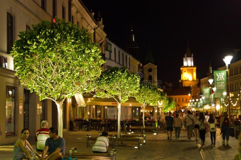 Lublin, Polonia, escena de la noche de la calle de Warszawskie Przedmiescie imagen de archivo libre de regalías