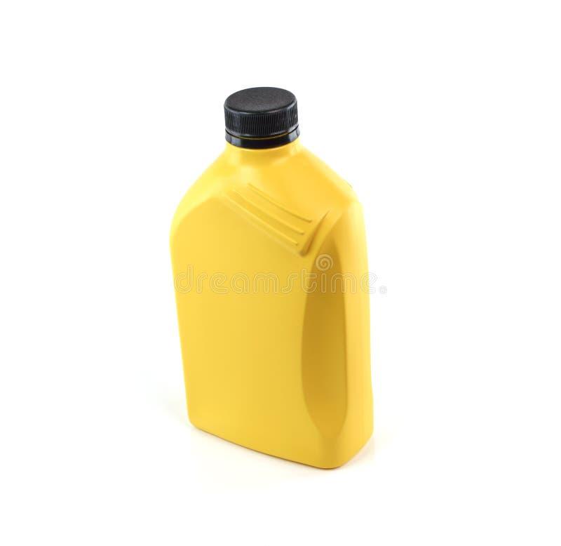 Lubrificanti, bottiglia di olio del motore isolata su fondo bianco fotografia stock