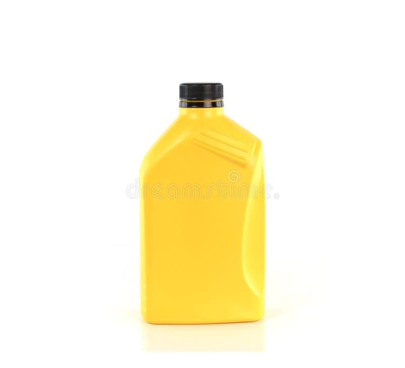 Lubrificanti, bottiglia di olio del motore isolata su fondo bianco immagine stock