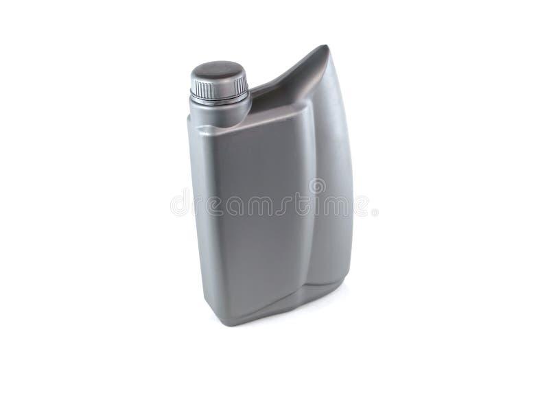 Lubrificanti, bottiglia di olio del motore isolata su fondo bianco fotografia stock libera da diritti