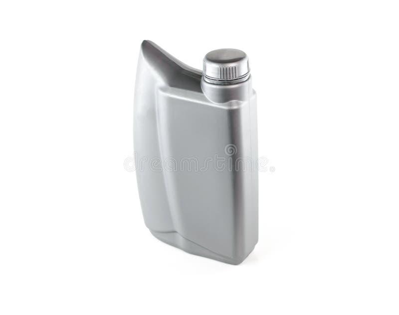 Lubrificanti, bottiglia di olio del motore isolata su fondo bianco immagini stock