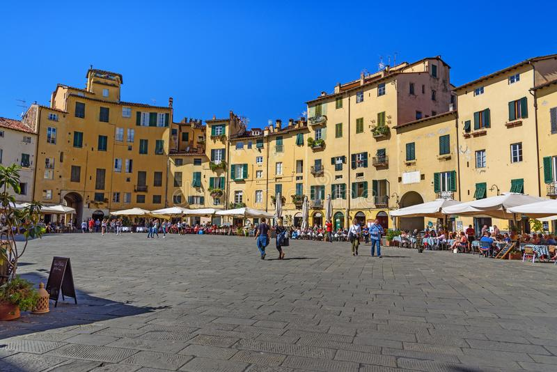 Amphitheater Square or Piazza dell`Anfiteatro in center of city. Lucca. Italy royalty free stock images