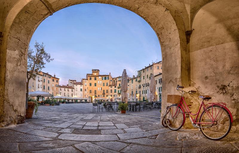 Lucca, Italy. View of Piazza dell`Anfiteatro square stock photo