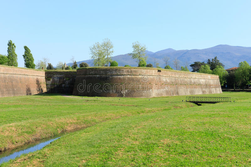 Lucca`s city walls. The town of Lucca in Tuscany is entirely surrounded by the renaissance-era city walls in the picture the San Paolino bastion stock photo