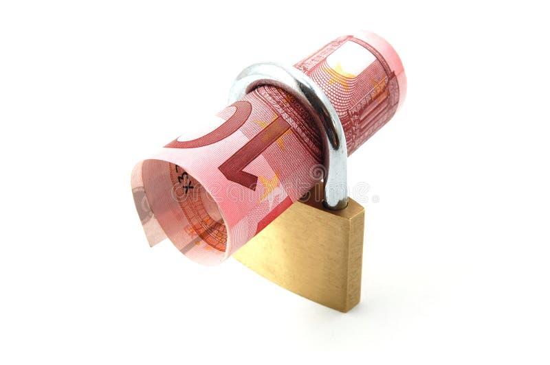 Lucchetto con soldi immagine stock