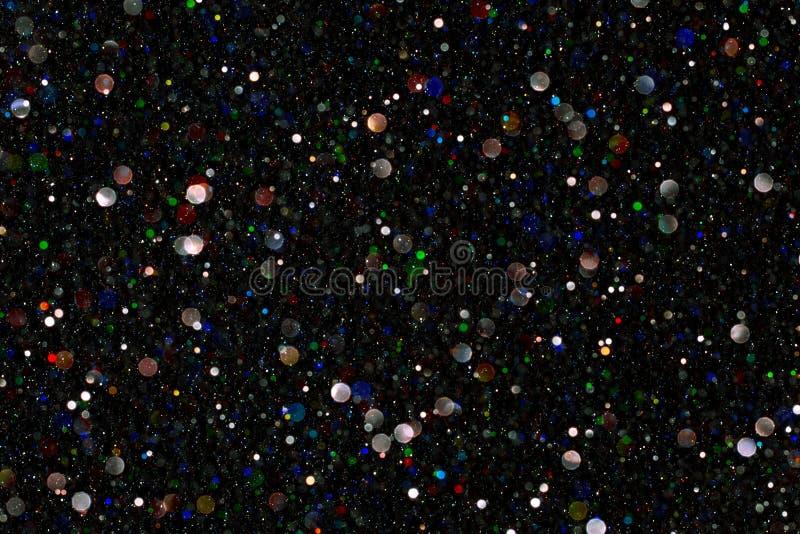 Luce delle scintille, polvere Bokeh di colore di De Focused Sparkling, nero immagini stock