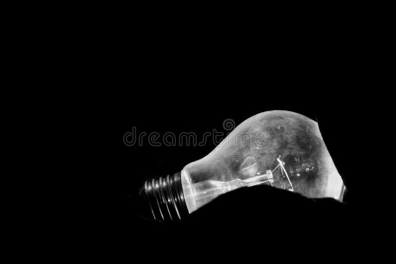 Luce di lampadina in bianco e nero fotografia stock