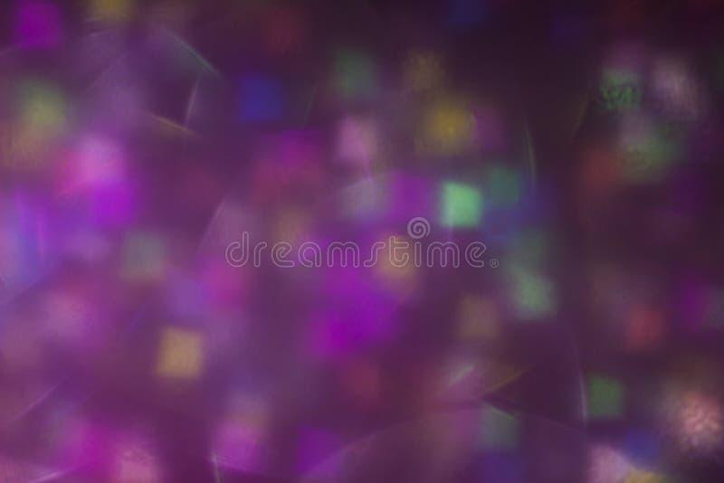 Luce intensa defocused vaga Chiarore della lente Punti brillanti fondo scuro, scintilla fotografie stock libere da diritti