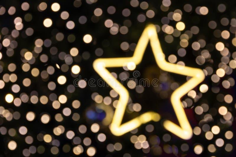 Luce vaga della stella del glittler di natale per fondo immagini stock libere da diritti