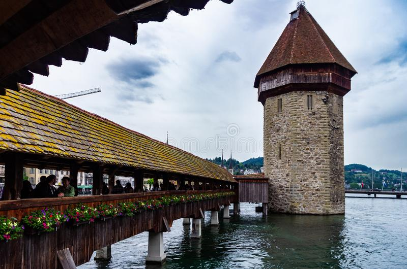 Lucerne Kapellbrucke bridge  scence from the old wooden bridge. Cloudy day stock photos