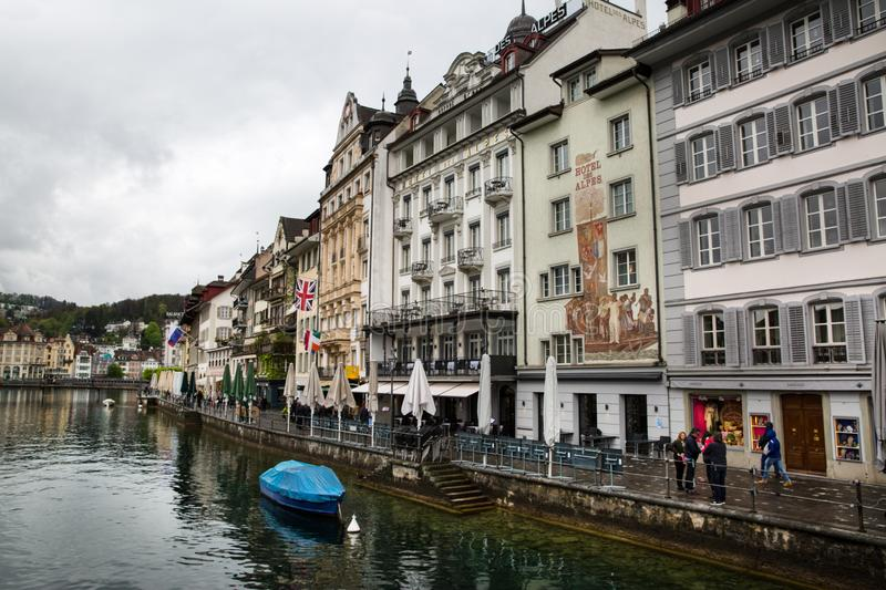 Lucerne, Switzerland. 16 April 2017. Embankment with shops and restaurants stock photography