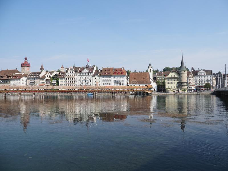 Panoramic view to historical buildings and chapel bridge at Reuss river at european city of Lucerne in Switzerland stock photo