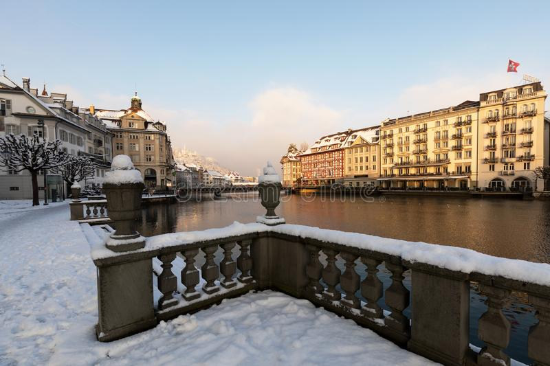 Lucerne, Switzerland, February 4, 2019: Old town of Lucerne with reuss river on a cold winter morning during sunrise. In central Switzerland stock image