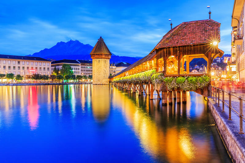 Lucerne, Switzerland. Historic city center with its famous Chapel Bridge and Mt. Pilatus on the background. Vierwaldstattersee stock photo