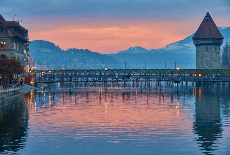 LUCERNE, SWITZERLAND - November 29, 2018: Sunset over the Wooden Chapel Bridge on the Reuss river in the Old Town of Lucerne royalty free stock image