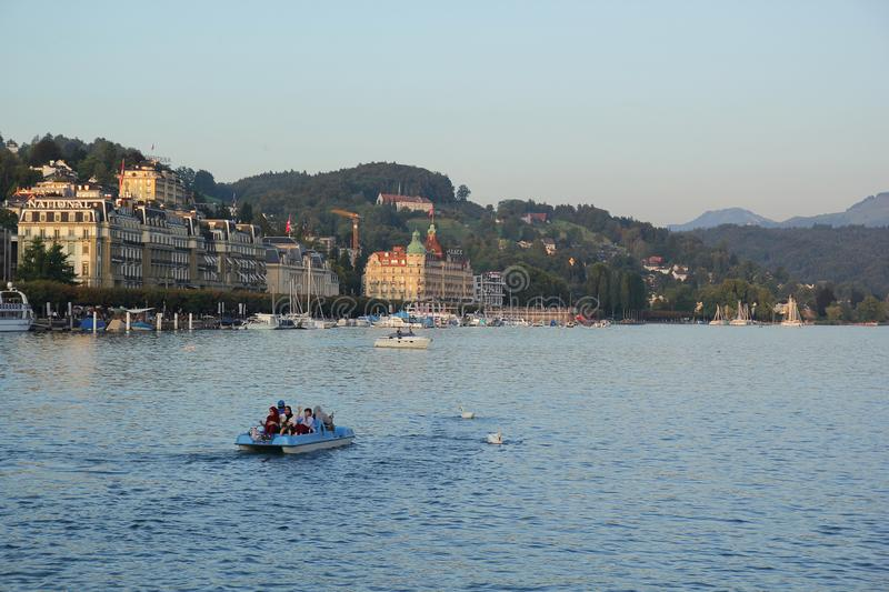 Lucerne, Switzerland - September 2,2017: Beautiful landscape with canoe, houses and the river stock photo