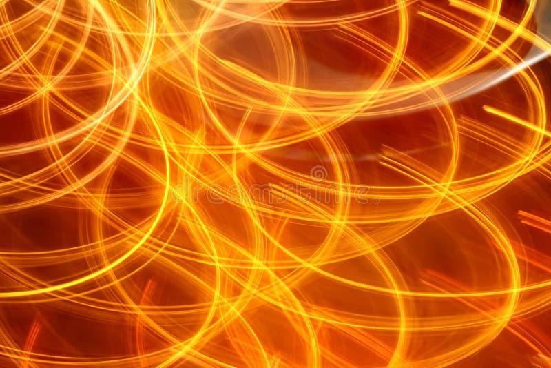 Luces anaranjadas rojas de la noche del fondo ligero abstracto fotos de archivo libres de regalías