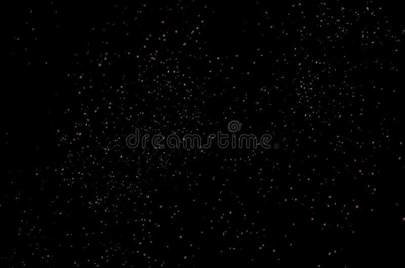 Luces blancas y ligeras en un fondo negro imágenes de archivo libres de regalías