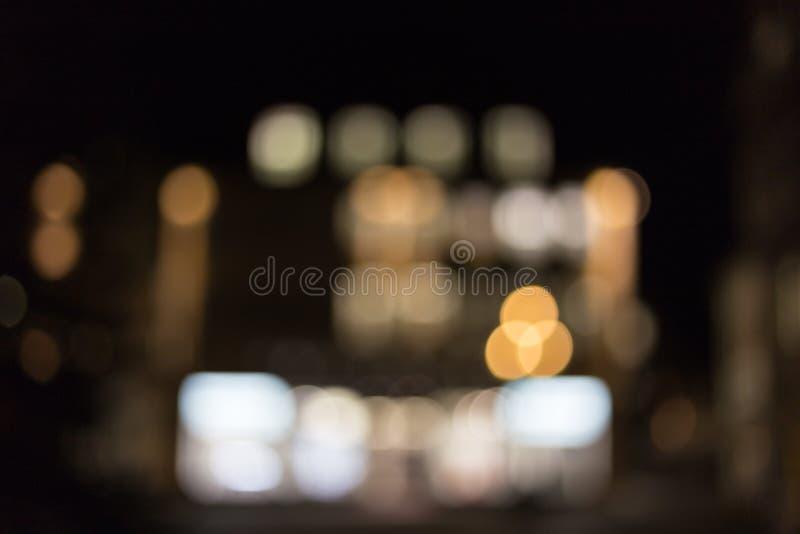 Luces de la ciudad en la noche con efectos del bokeh fotografía de archivo libre de regalías