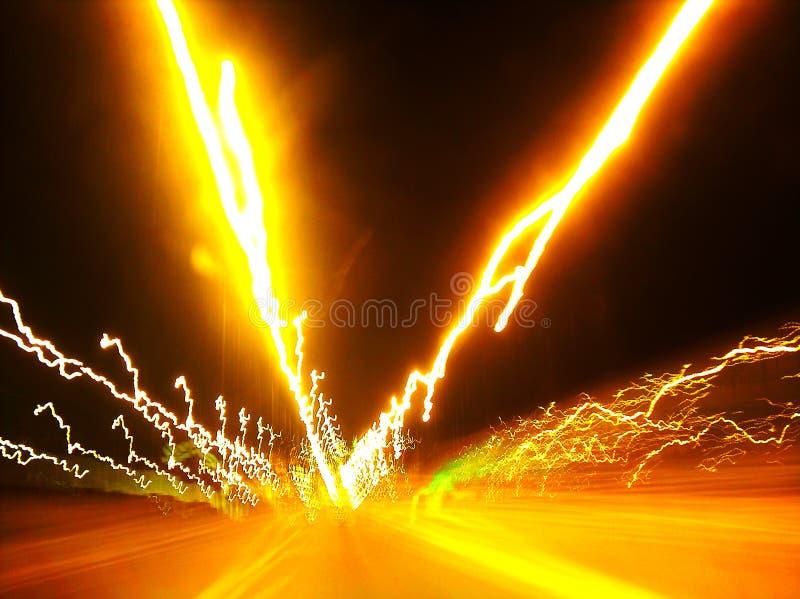 Luces del camino en el movimiento imagen de archivo