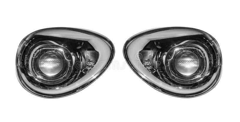 Luces del coche aisladas en el fondo blanco foto de archivo libre de regalías