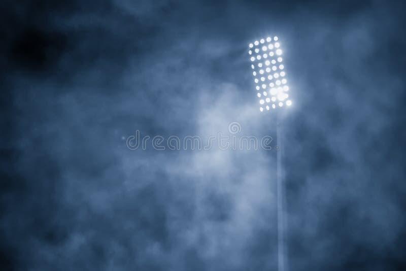 Luces y humo del estadio imagen de archivo