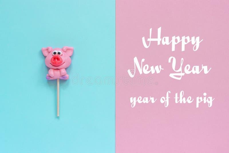 Lucette de porc et bonne année des textes photographie stock