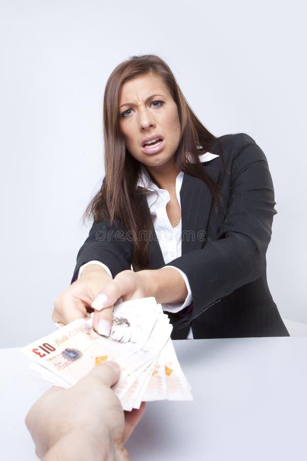 Lucha de la empresaria sobre el dinero foto de archivo