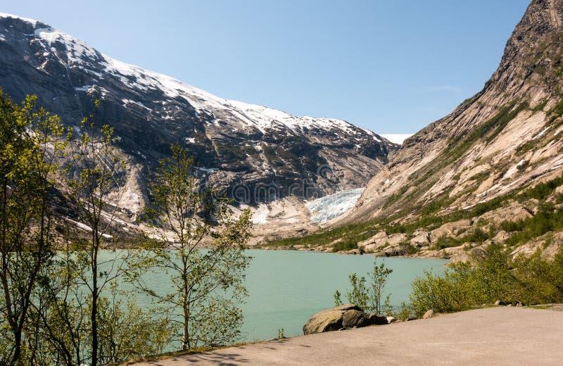 Luchthommel van Nigardsbreen-gletsjer in het nationale park van Nigardsvatnet Jostedalsbreen in Noorwegen in een zonnige dag stock afbeelding