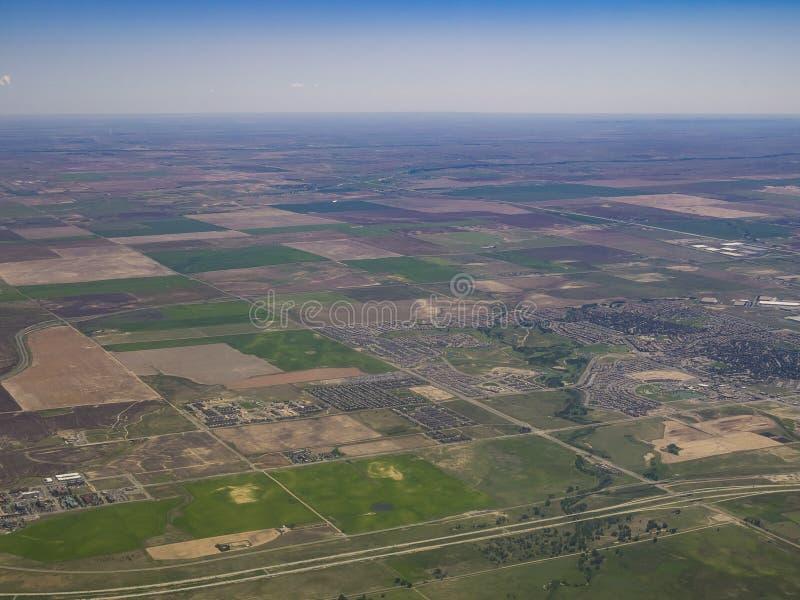 Luchtmening van Dageraad, mening van vensterzetel in een vliegtuig royalty-vrije stock afbeeldingen