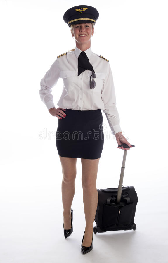 Luchtvaartlijnambtenaar in eenvormig dragend een korte rok stock fotografie