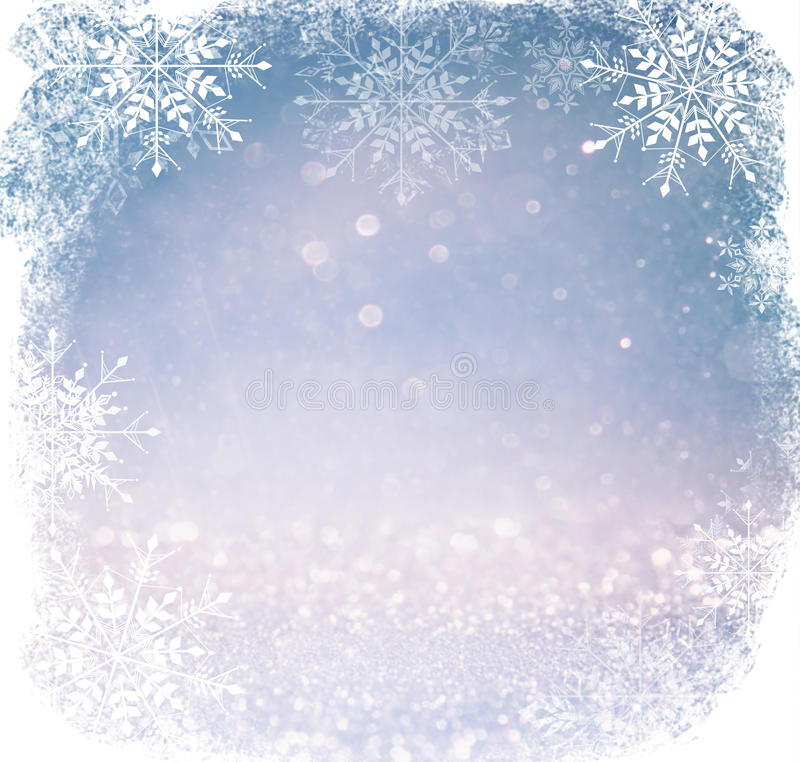Luci astratte bianche e d'argento del bokeh fondo defocused con la sovrapposizione del fiocco di neve immagini stock