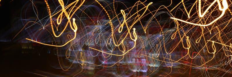 Luci astratte del fondo di una notte immagine stock