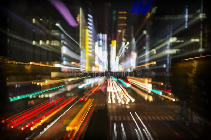 Luci astratte della città di Tokyo immagini stock libere da diritti