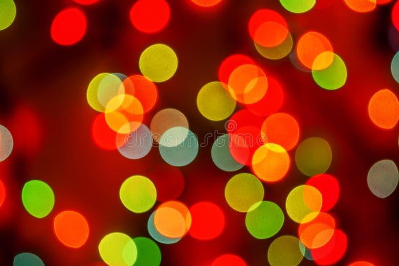 Luci confuse del bokeh defocused multicolore, luci di Natale, Fe fotografia stock