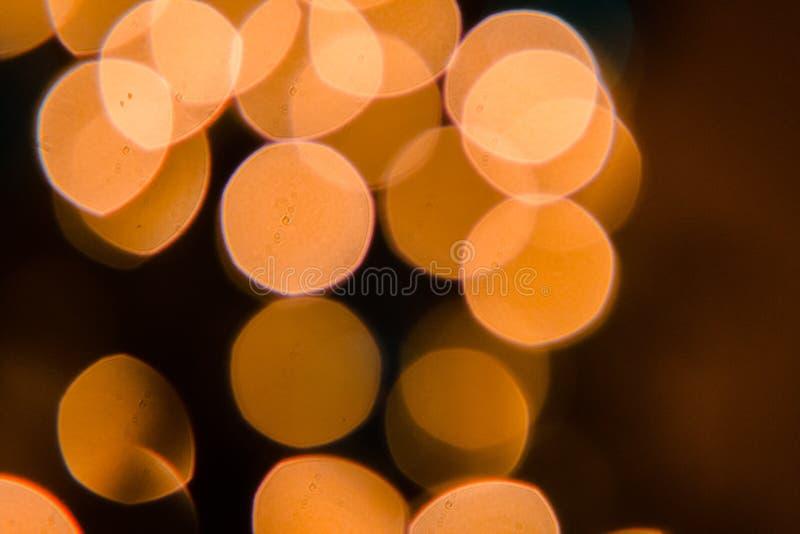 Luci di Natale che ostentano la sfuocatura del bokeh immagine stock