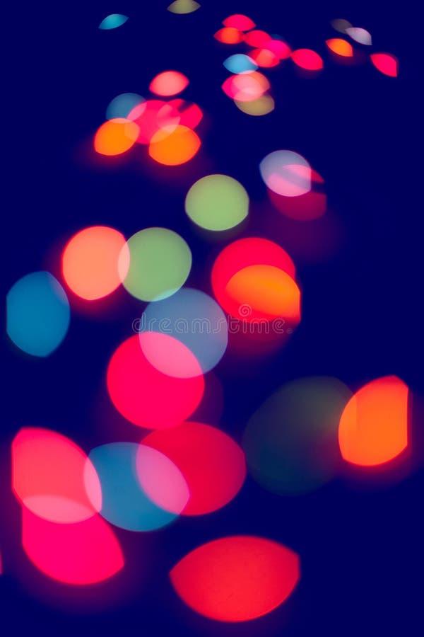 Luci festive defocused multicolori di scintillio immagini stock libere da diritti