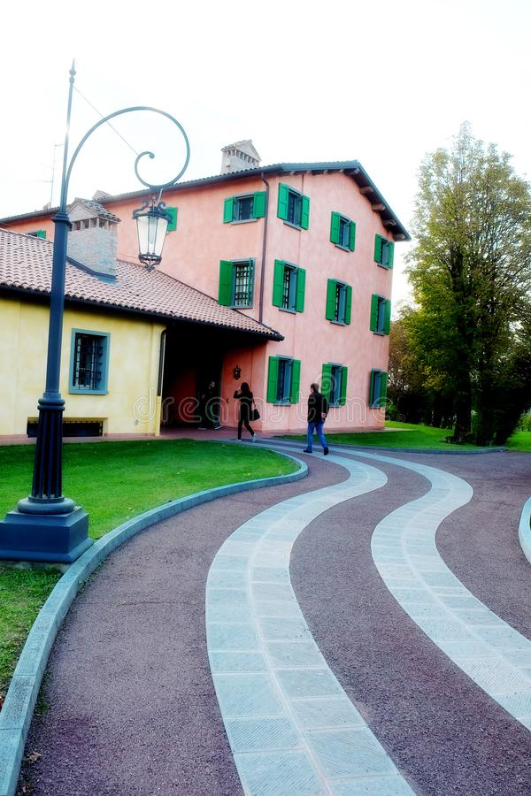 Luciano Pavarotti house in Modena, Italy. The orange house with green windows of Luciano Pavarotti house in Modena, Italy royalty free stock photos