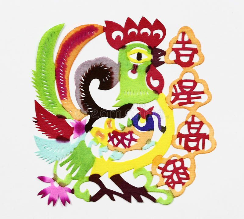 "Luck star. Paper-cut of a rooster together with four Chinese characters which mean ""A lucky star shone upon so as to bring somebody good luck and success royalty free stock photo"