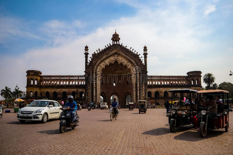LUCKNOW, INDIA - DEC 19: Tourist and citizens near the famous historical gateway Rumi Darwaza at the sunny day on. December 13,2019 in Lucknow, India royalty free stock photo