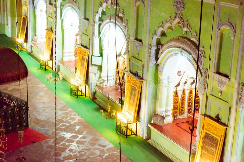 Inside of the bhool bhulaiya complex in bara imambara lucknow. Lucknow, India - 3rd feb 2018: The beautiful green arches and relics of the bara imambara in royalty free stock image