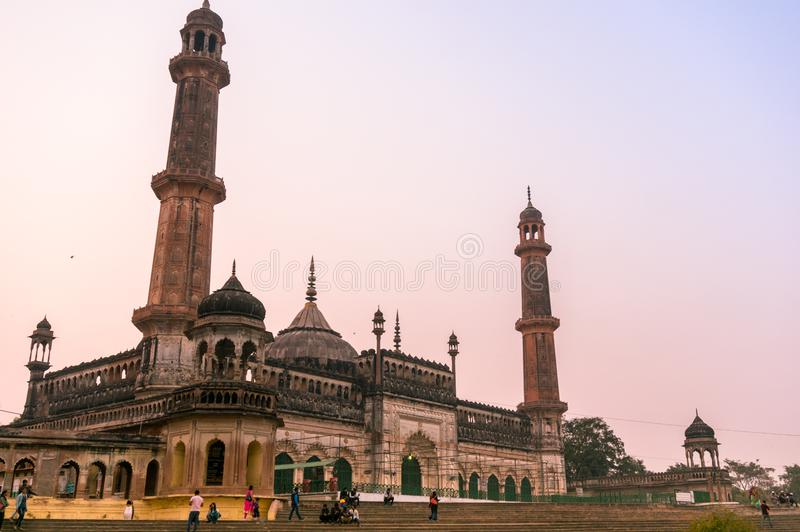 Entrance and gardens of the Asfi mosque in Lucknow. Lucknow, India: 3rd Feb 2018: The entrance and gardens of the bara imambara. The spires and dome of the main stock photography