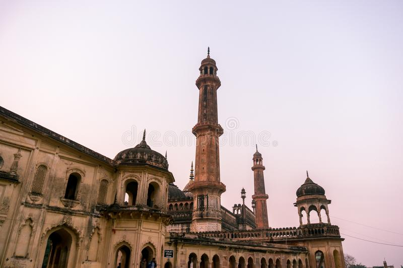 Closeup of the entrance gate of the asfi mosque in lucknow. Lucknow, India: 3rd Feb 2018: The entrance and gardens of the bara imambara. The spires and dome of royalty free stock images