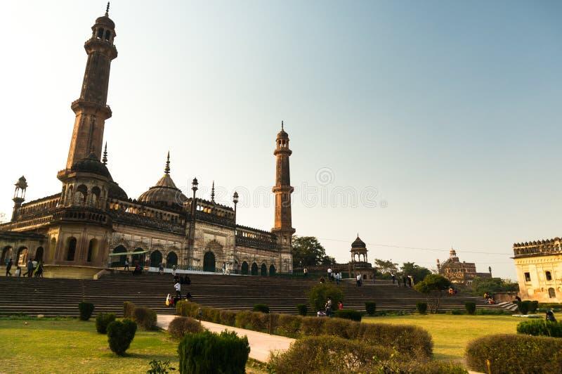 The bara imambara mosque and gardens in lucknow. Lucknow, India: 3rd Feb 2018: The entrance and gardens of the bara imambara. The spires and dome of the main stock photos