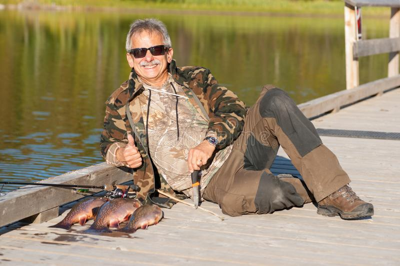 Lucky Angler with his Catch stock photo