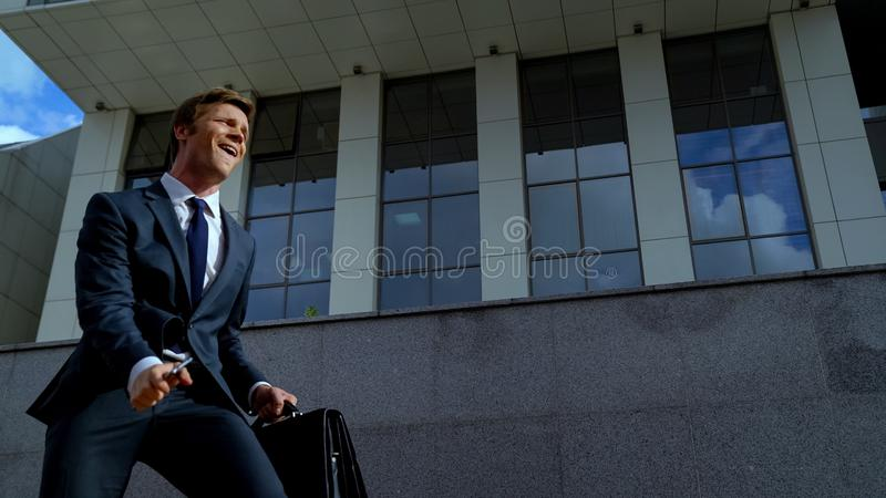 Lucky broker celebrating successful deal, employee getting promotion, happy male. Stock photo stock photography